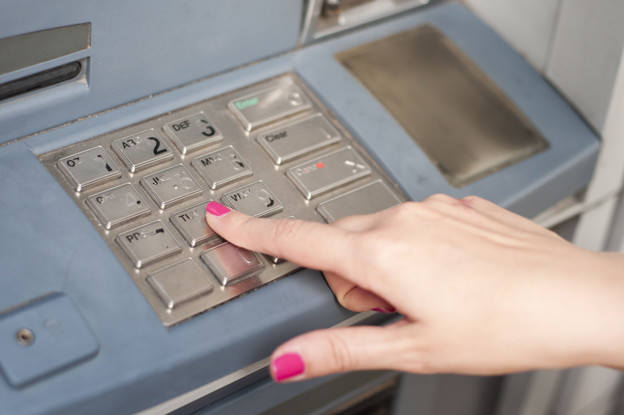 Finger pressing password number on ATM machine